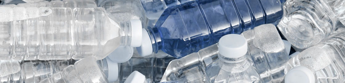 Plastic bottles ready to be recycled by baler equipment